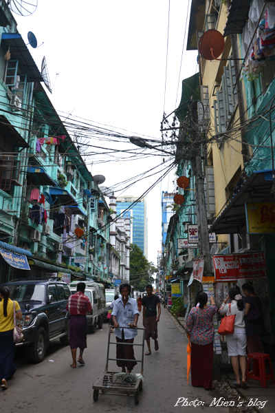 Vietnam-style apartment buildings and electric wires in the center of Yangon